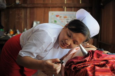 A midwife provides a regular health check for a pregnant woman in Tone Le Village, Tone Le Sub Centre, Nyaung Shwe Township, Shan State, Myanmar.
