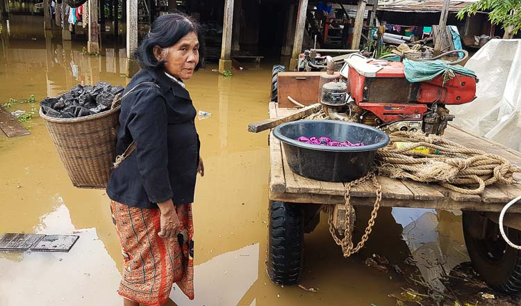 A woman packs her belongings and gets gets ready to move. KT/May Titthara