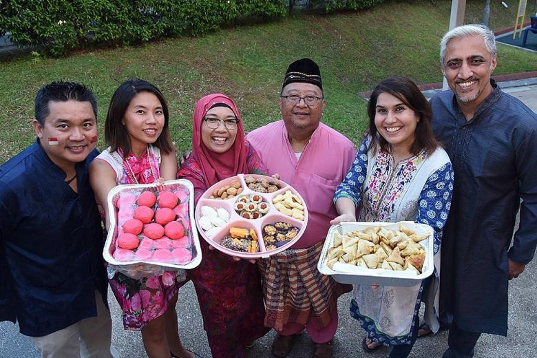 Ulu Pandan residents sharing desserts from different cultures. MPs such as Mr Christopher De Souza and Mr Gan Thiam Poh have noted how food can be a unifying experience across cultures.PHOTO: ULU PANDAN GRASSROOTS ORGANISATIONS