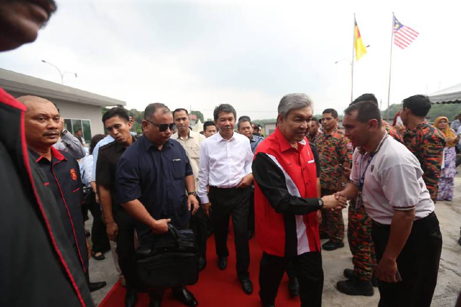 Deputy Prime Minister Datuk Seri Dr Ahmad Zahid Hamidi (second from right) arriving at the HyFresh factory in Pedas, Negri Sembilan. Pix by Hazreen Mohamad