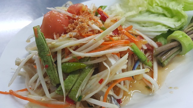 Thai green papaya salad. This dish is dressed with a tangy sauce that whets the appetite.