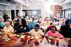 The Asheville, North Carolina, nonprofit Green Opportunities hosts lunches and dinners for its community. Courtesy Green Opportunities