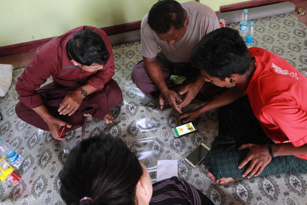 Farmers learn how to use the Green Way app at a training session in Ye Township, southern Mon State. (Supplied)