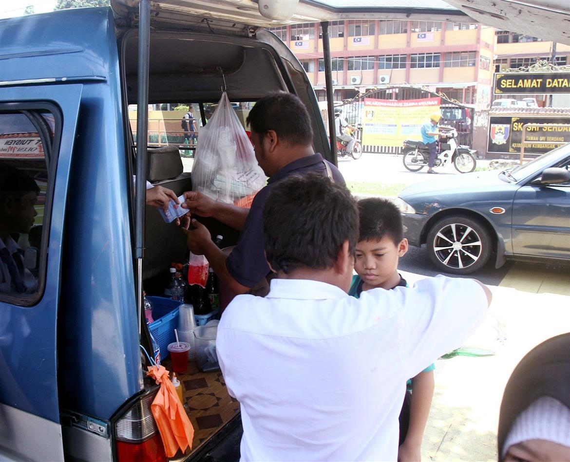 While the national policy is to restrict the promotion of unhealthy foods in childrens settings, street vendors selling junk food and sugary drinks outside schools are not uncommon, as seen in this filepic.